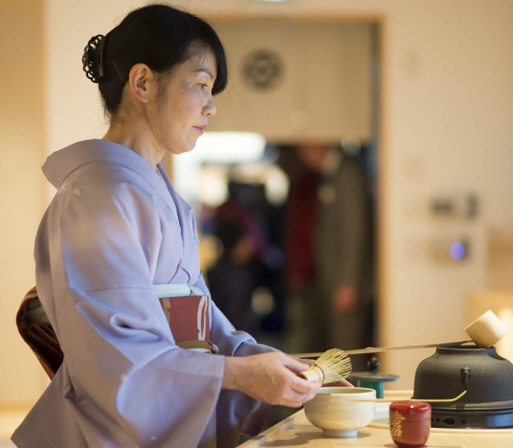 Japanese woman in kimono tea ceremony